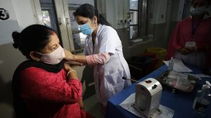 A woman receiving COVID vaccine jab at government hospital, Jammu-The Dispatch