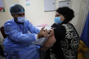 A-health-worker administering COVID-19-vaccine at Government hospital Shri-Maharaja-Gulab-Singh at Jammu