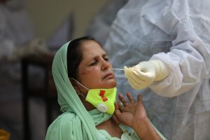 A health worker collects swab samples for COVID-19 tests in Jammu -The Dispatch