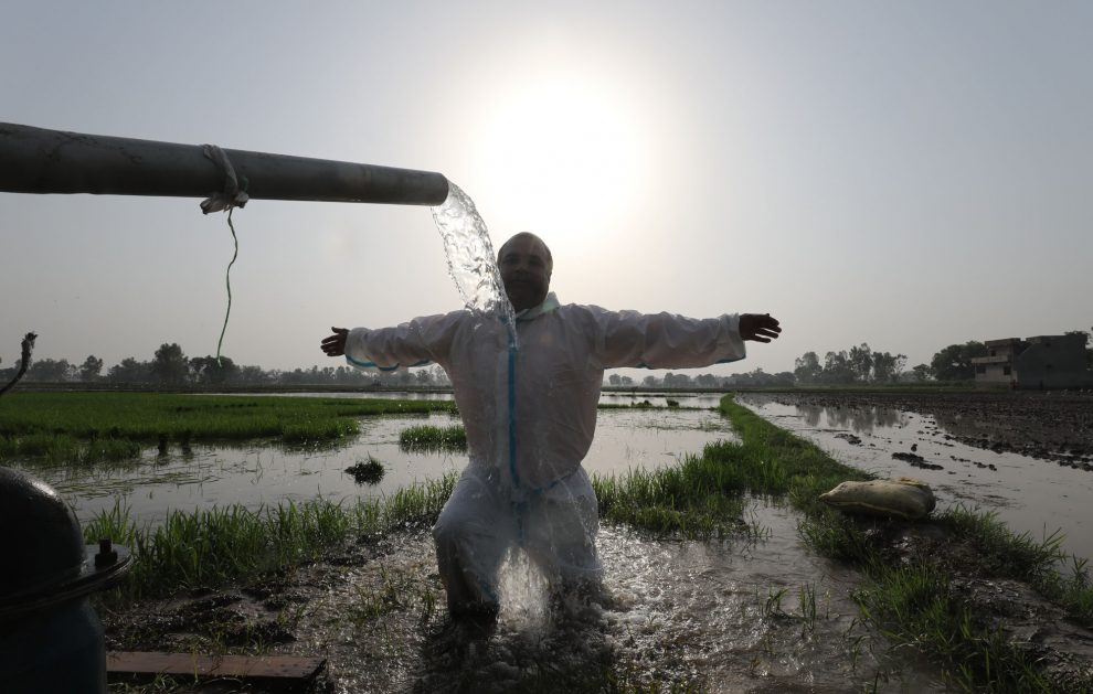 A health worker cooling down himself in agriculture field. The Dispatch